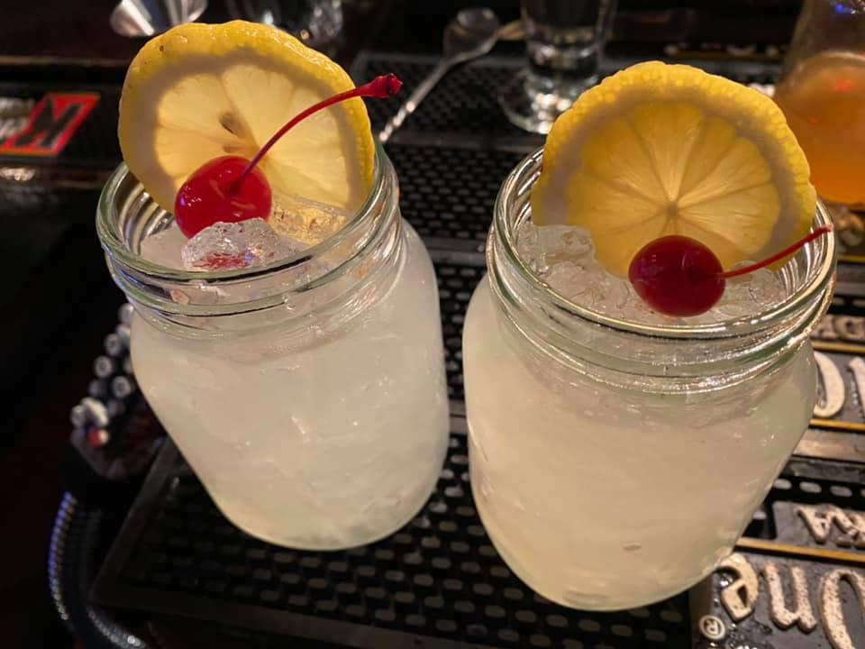 Blind Lemon Jefferson Cocktail in Mason Jar garnished with orange wedge and cherry